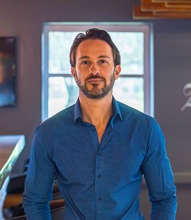 Man in blue button shirt